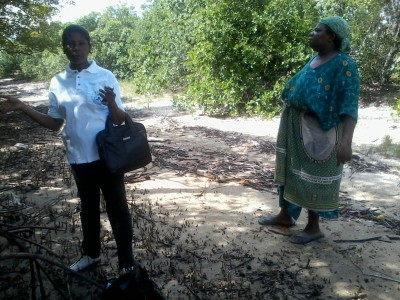 Charperson of DSMC and the local mangoves leader during identification of the area for mangroves replanting.jpg