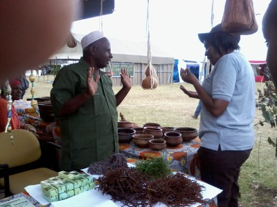 Seaweed farmer explaining something to one of the Officer from the Ministry of Tourism.jpg