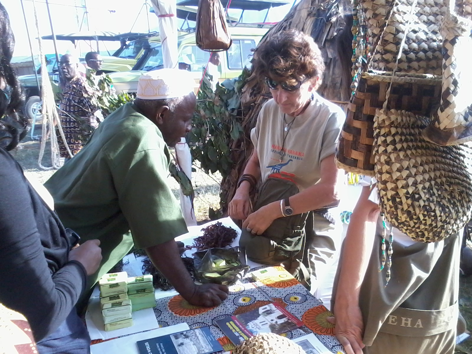 seaweed farmer explaining something to one of the guest at the exihibition in Arusha.jpg